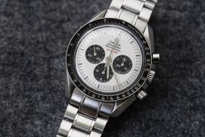 "Stuttgart, Germany - May 26, 2016: Omega Speedmaster Professional Apollo XI 35th Anniversary Chronograph with rare White Dial, black bezel and steel bracelet. The Speedmaster Apollo XI 35th Anniversary: Ref. SU 145.0227 is a very rare one, with its white 'Panda' Dial – a white face with black sub-counters. Under the mention Professional at 12 is written in red ""July 20, 1969""."